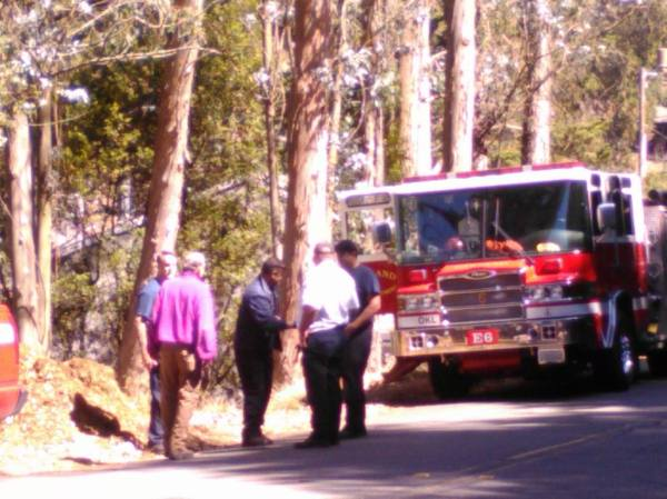 Fire truck called to hose down steaming pile of wood chips, September 3, 2015